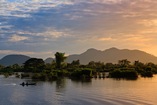 Fishermen on the Mekong River at sunset, located on Don Det Island which forms part of the Four Thousand Islands, known locally as Si Phan Don.